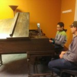 Monument Square Music school's student Jonathan working on a new piece with his teacher, Joe Mazzarella